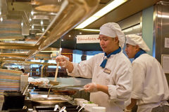 Cruise Ship Cooks Working. Two men at the breakfast omelete station on a large cruise ship royalty free stock photos