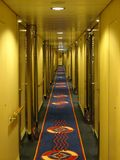 Ship corridor leading to rooms recedes into the distance stock images