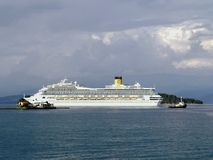 Cruise Ship Costa Magica leaving port. Costa Magica cruise ship leaving harbour with tugs Stock Images