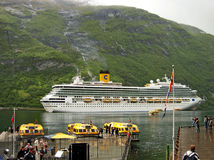 Cruise ship Costa Magica in the port of Geiranger in Norway. Geiranger, Norway - June 3, 2009: The cruise ship Costa Magica of the shipping company Costa Cruises Stock Photo