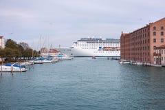 Cruise ship crosses the Giudecca Canal Royalty Free Stock Photo