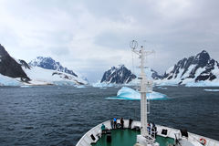 Cruise ship crusing around ice floes in Antarctic waters. Antarctica royalty free stock images
