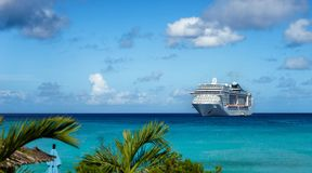 Cruise ship in crystal blue water. With blue sky Stock Image