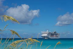 Cruise ship in crystal blue water. With blue sky Stock Photo