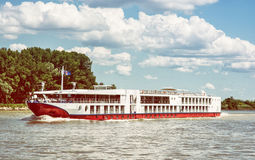 Cruise ship and Danube river, travelling scene, retro photo filt Royalty Free Stock Images