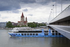 Cruise ship on Danube with St. Francis of Assisi Church on Mexikoplatz on 7 May 2012 in Vienna, Austria Royalty Free Stock Photo