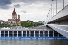 Cruise ship on Danube with St. Francis of Assisi Church on Mexikoplatz on 7 May 2012 in Vienna, Austria Stock Photo
