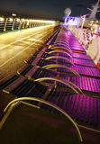 Cruise ship deck. Sun loungers and running track on the deck of a cruise ship at night Royalty Free Stock Image