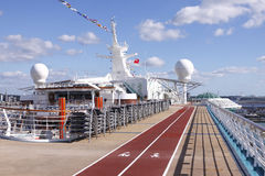 Cruise Ship Deck. A colourful shot of running track on the deck of a cruise ship on a beautiful sunny day Royalty Free Stock Image