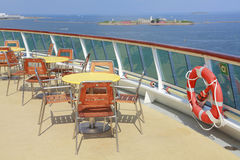 Cruise ship deck. With tables, chairs and life preserver ring stock photo