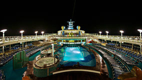 Cruise Ship Deck. Cruise ship outdoor pool deck at night Stock Photos