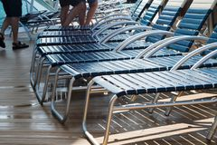 Cruise ship deck chairs outdoors. Vinyl chairs for sunning and relaxing on cruise ship deck outdoors stock photo