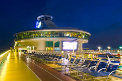 Cruise ship deck at evening. Top deck of cruise ship at blue hour. Vessel is the Mariner of the Seas, operated by Royal Caribbean International Stock Images