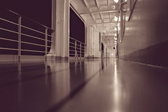 Cruise ship deck. Illuminated deck of cruise ship at night, monochrome image Royalty Free Stock Photo
