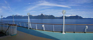 Cruise ship deck and mountain panorama Stock Photos