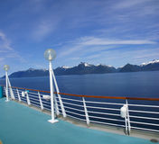 Cruise ship deck and mountain panorama. Inside Passage, Alaska Royalty Free Stock Photo