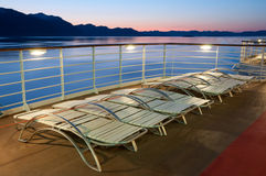 Cruise ship deck at night. Upper deck of a cruise ship in Alaska. Motion blur on the horizon; focus on the deck Stock Photo