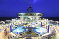 Cruise ship deck at night. Cruise ship deck and pools at night