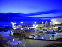 Cruise ship deck at night. With blue sky Stock Photos