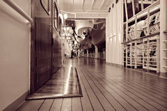 Cruise ship deck at night. Illuminated deck of cruise ship at night, monochrome image Stock Images
