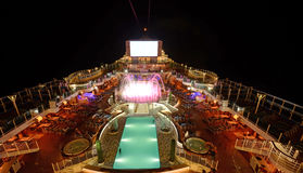 Cruise ship deck at night. Cruise ship deck illuminated at nght in open waters Stock Photos