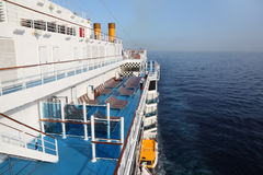 Cruise ship deck in ocean view from above. Cruise ship deck with blue floor in ocean view from above royalty free stock image