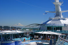 Cruise ship deck and pool with Mt. Rainier Royalty Free Stock Photo