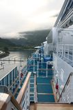 On a cruise ship deck in Whittier, Alaska. On the side deck of a cruise ship in Whittier, Alaska, with low clouds and mountainous view Stock Photo