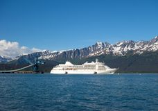 A cruise ship departing seward in the springtime Stock Photography