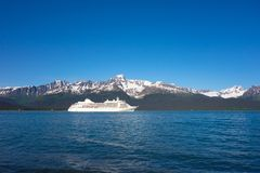 A cruise ship departing seward in the springtime Stock Image