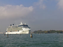 Cruise ship departing Venice. Venice, Italy, Nov 28, 2011: Cruise ship Celebrity Solstice departing Venice and passing Lido Island.  Cruise ships which are based Royalty Free Stock Photo