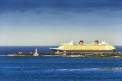 Cruise Ship Departs Bahamas. Nassau, Bahamas - March 3, 2018: Disney Cruise Ship departing the port of Nassau in the Bahamas stock photo