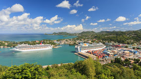 Cruise Ship Destination. Cruise ships Carnival Valor and P&O Ventura docked in Castries. The sheltered harbour offers a preferred destination for cruise ships Stock Images