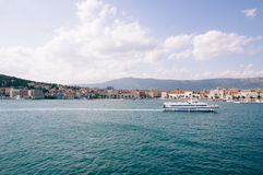 Cruise Ship in a Distance of a Building at Daytime Royalty Free Stock Photo
