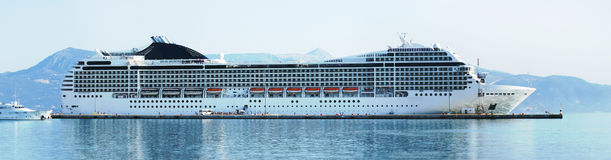 Cruise ship in dock. Big cruise ship docked in port. Panoramic image shot in Corfu, Greece Royalty Free Stock Photography