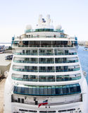 Cruise Ship at Dock from Front. Modern White Cruise ship from front at a port Royalty Free Stock Image