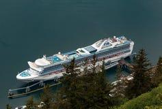Cruise Ship at Dock. Juneau, AK, USA - May 25, 2016:  The cruise ship Grand Princess docked in Juneau, Alaska Stock Images