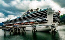 Cruise Ship at Dock. Juneau, AK, USA - May 25, 2016:  The cruise ship Grand Princess at dock in Juneau, Alaska Royalty Free Stock Photo