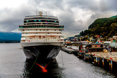 Cruise Ship At Dock. Ketchikan, Alaska, USA - September 15, 2016: The cruise ship Nieuw Amsterdam of the Holland America Line arrives in Ketchikan, Alaska for stock photos