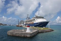 A cruise Ship at Dock at the Royal Naval Dockyard, Bermuda. A cruise ship docked at the Royal Naval Dockyard in Bermuda - clear turquoise waters and a sub royalty free stock photos