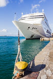 Cruise ship docked. Detail of cruise ship docked at port showing mooring lines or hawsers Stock Photos