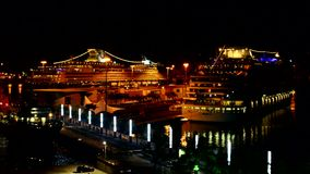 Cruise ship docked in harbor at night stock video footage