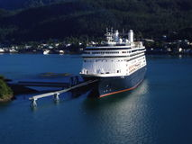 Cruise ship docked in Juneau, Alaska harbor. With mountains in backgorund stock photo
