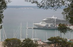 Cruise ship docked in Palma de mallorca view from Bellver hill. Big cruise ship docked in the city of Palma de Mallorca view from nearby hill of Bellver. Local Royalty Free Stock Images