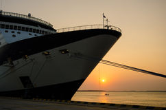 Cruise ship docked at port at sunset Royalty Free Stock Images