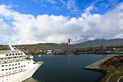 Cruise ship docking in Ensenada Mexico. A cruise ship docking in Ensenada Mexico with the Mexican Flag flying Stock Photography