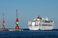 Cruise Ship Docking In Lisbon. A big white cruise ship, arrives in Lisbon, in a sunny summer day Stock Photo