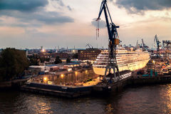 Cruise ship in dry dock in Hamburg harbor in the evening Stock Photography