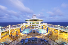 Cruise ship at dusk. Deck on board a luxury cruise ship liner at dusk