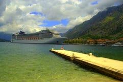 Cruise ship in emerald water bay,Kotor Stock Image